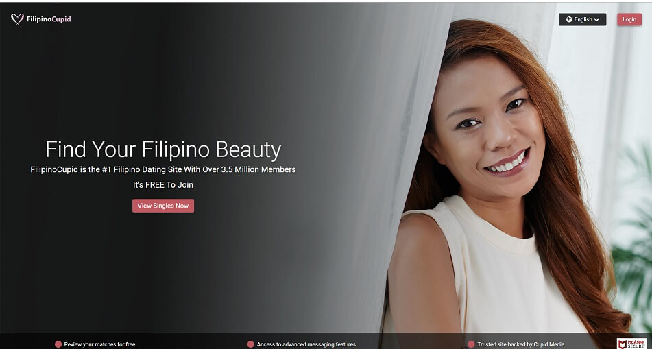 pretty filipina leaning into curtain looking at camera smiling