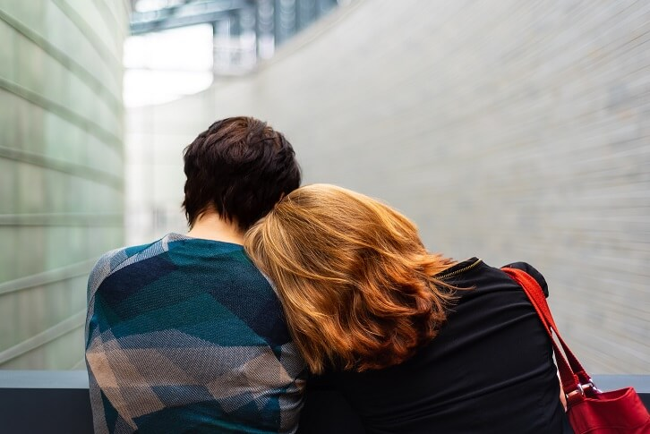 lesbian couple cuddling