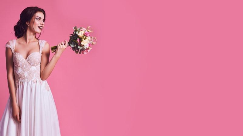 pretty brunette mail order bride showing off her wedding bouquet