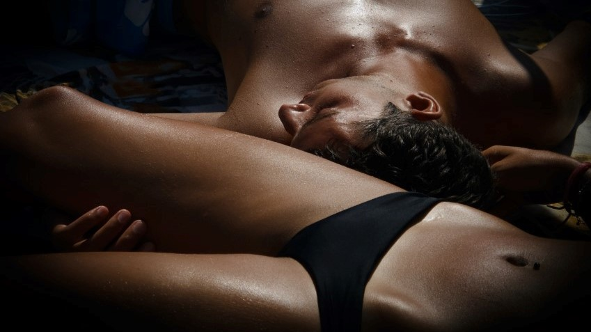Man and woman lying down next to each other