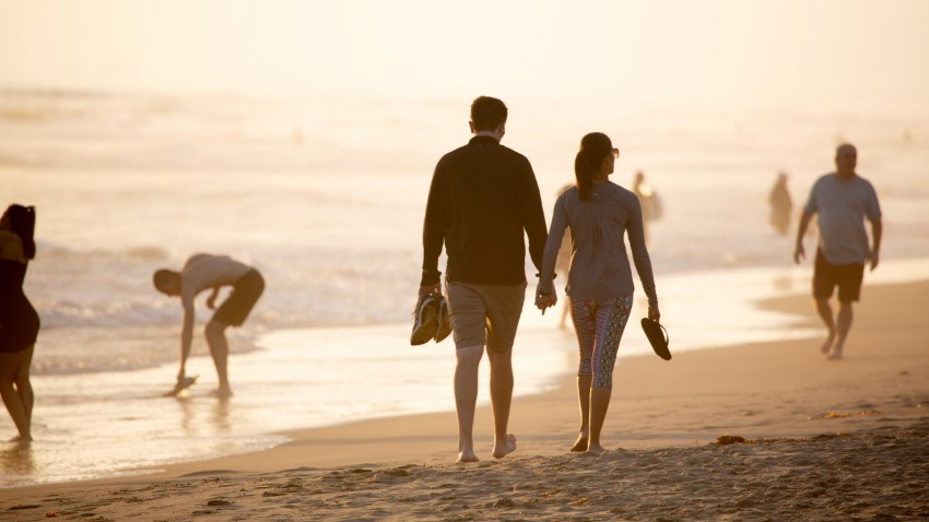 Relaxed couple is walking on the beach