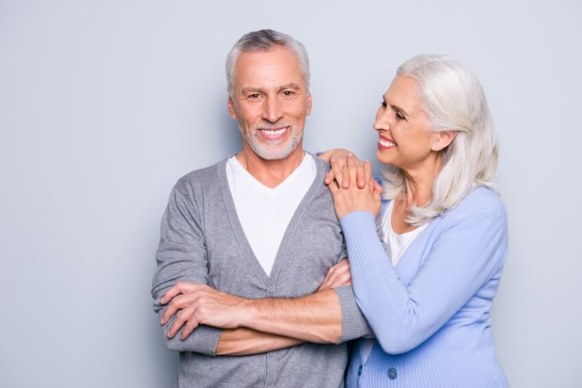 Smiling mature couple with silver hair