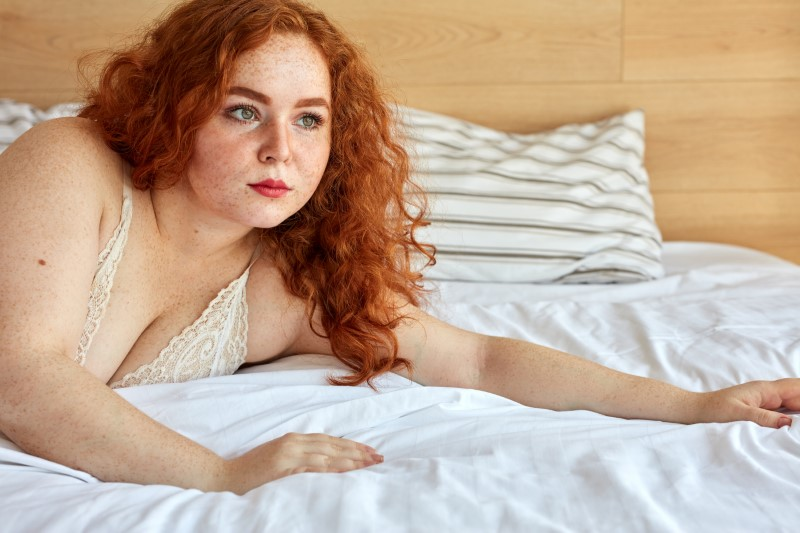 beautiful ginger plus size woman with freckles