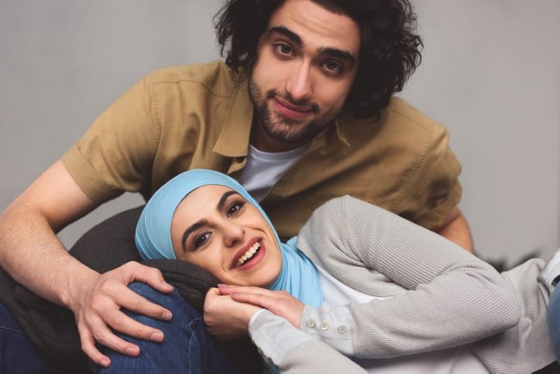 muslima lies on lap of her boyfriend