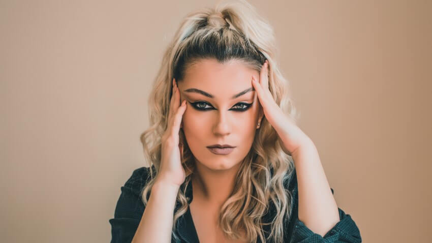 attractive transgender woman with heavy makeup