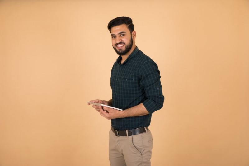 handsome arab muslim single man with tablet