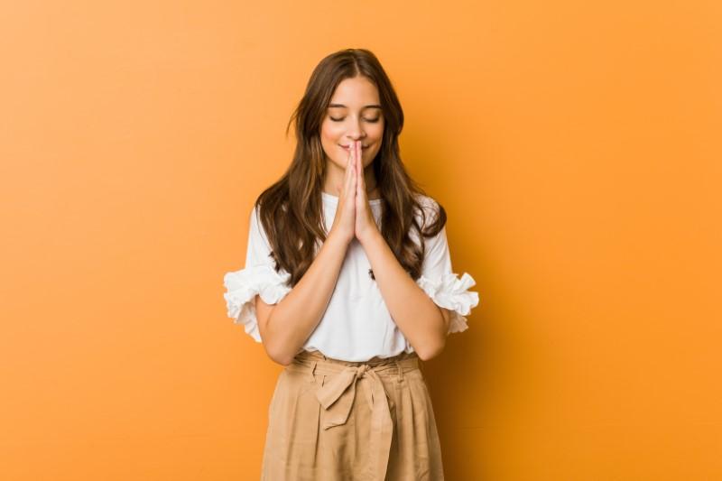 long-haired christian woman praying