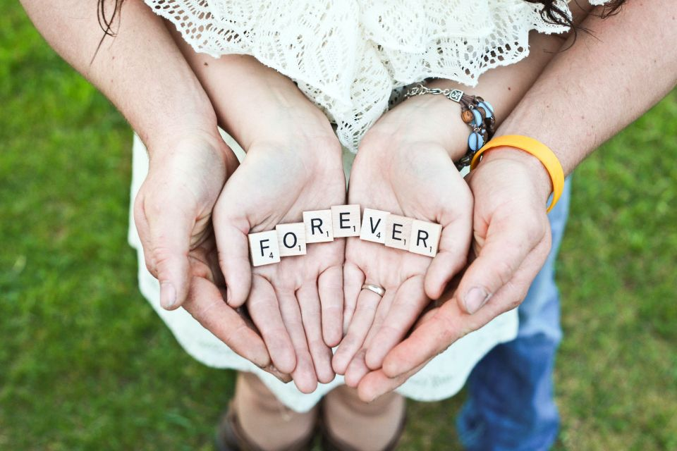 Couple holding the letters of the word 'forever' in their hands