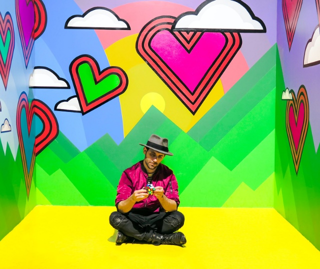 Single weird dater in a colorful room
